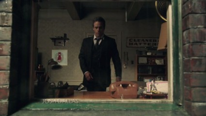 "Neal Cassidy's Manhattan room (with ""Cleaner and Hatters"" sign in the background), as seen in episode 2x01 ""Broken"""