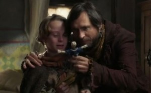 Young Rumple's father giving him the doll